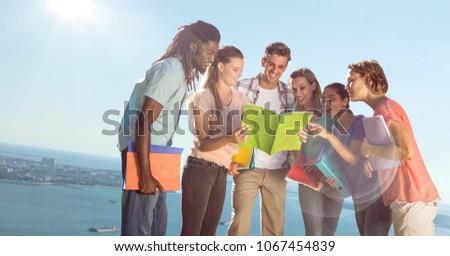 College students against blurry slanted coastline Stock photo © wavebreak_media