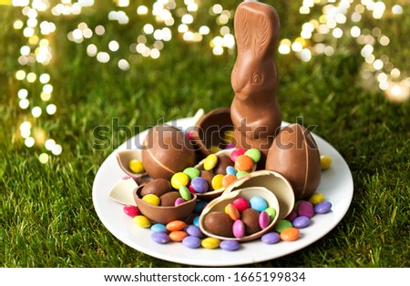 chocolate bunny, eggs and candy drops on grass Stock photo © dolgachov