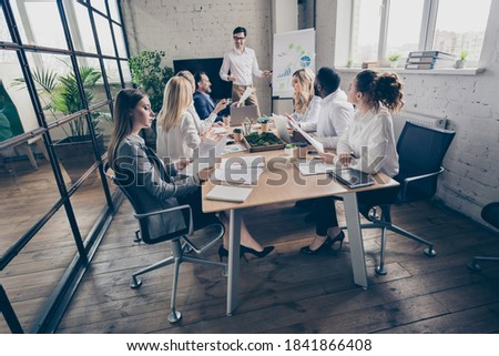 side view of diverse business partners presenting to colleagues in a bright modern office they are stock photo © wavebreak_media