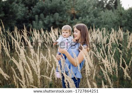 Mãe bebê floresta grama sorrir mulheres Foto stock © Lopolo