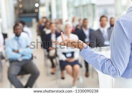 Rear view of  Caucasian female speaker speaks to diverse business people  in a business seminar in c Stock photo © wavebreak_media