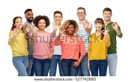 group of smiling friends showing ok hands sign Stock photo © dolgachov