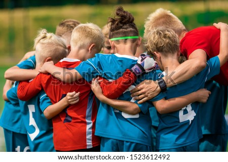 Happy Sports Boys in a School Team. Kids Huddling in a Team on Tournament Competition Before the Fin Stock photo © matimix