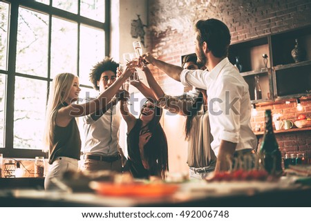 Low angle view of group of Multi ethnic friends toasting beer bottle at beach in the sunshine surrou Stock photo © wavebreak_media