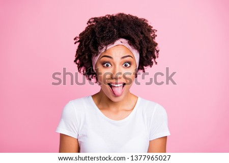 Image of young excited woman sticking out her tongue and gesturing horns Stock photo © deandrobot