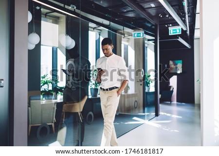 businessman texting on smartphone at office Stock photo © dolgachov