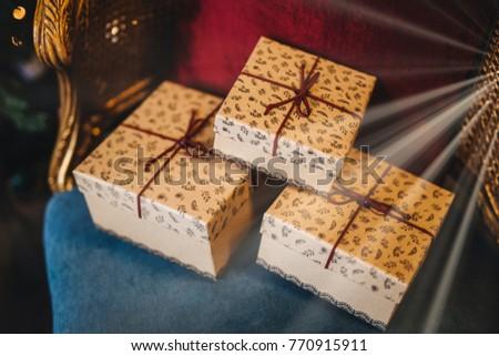 Wrapped gift boxes lie on armchair. Prepared surrpise on birthda Stock photo © vkstudio