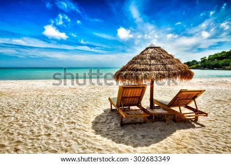 Two beach lounge chairs under tent Stock photo © dmitry_rukhlenko