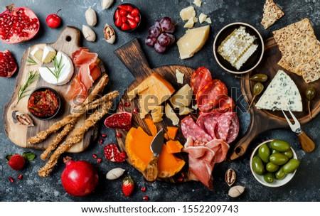Cheese, meat, grapes and olives antipasto Stock photo © karandaev