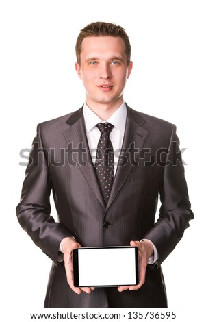 Young Businessman Showing A Tablet Pc Comuter With Blank Screen For Your Sample Text Foto d'archivio © Len44ik