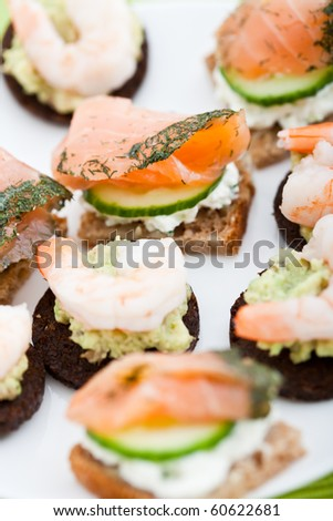 Stock photo: appetizer of smoked salmon king prawns cucumber and cream chee
