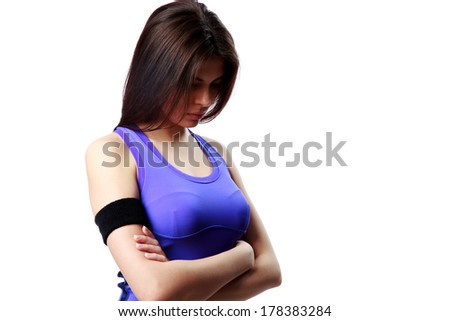 young tired sport woman with arms folded isolated on white background stock photo © deandrobot
