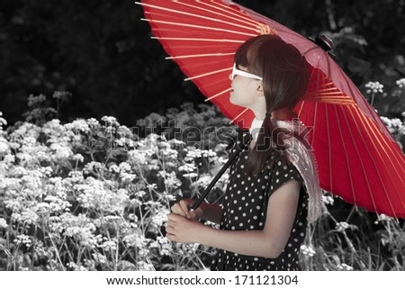 Beautiful Asian girl in a bright polka-dot dress and red shawl Stock photo © AntonRomanov