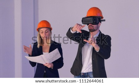 Construction engineer with VR goggles managing building project Stock photo © stevanovicigor