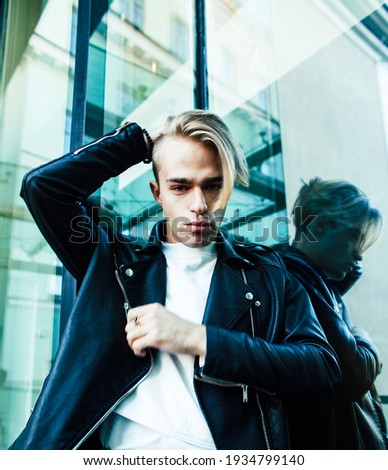 young modern hipster guy at new building university blond fashion hairstyle having fun, lifestyle pe Stock photo © iordani