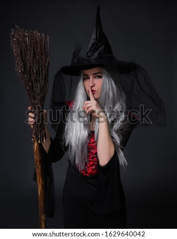 Frightening woman in halloween costume showing silence gesture Stock photo © deandrobot