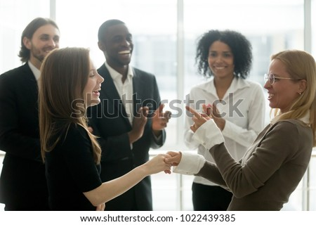 young businesswoman celebrates success on while talking on the p Stock photo © feedough