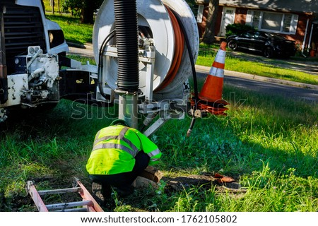 Plumber and dirty toilet. Cleaning pipes. Repair of plumbing. Ve Stock photo © MaryValery