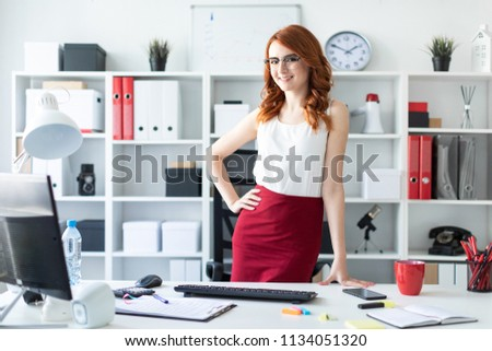A young girl in glasses stands at the office and puts her hands on the back of the chair. Stock photo © Traimak