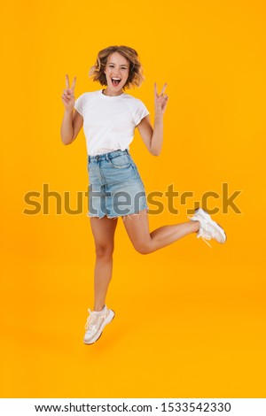 Full length photo of lovely blond woman in basic clothing smilin Stock photo © deandrobot