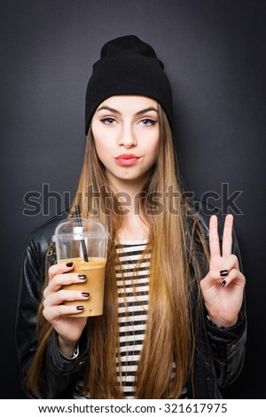Stock photo: Image of caucasian woman wearing jacket holding takeaway coffee