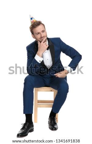 seated elegant man thinking, wondering and celebrating birthday Stock photo © feedough