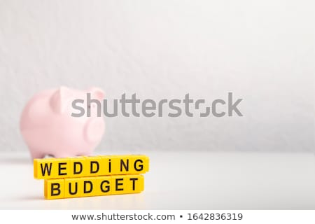 pink piggy bank with wedding rings stock photo © andreypopov