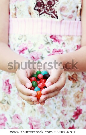 close up of hands holding red jelly candies Stock photo © dolgachov