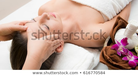 beautician doing face massage to woman at spa Stock photo © dolgachov