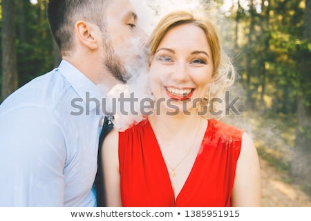 Foolish businessman in love with kisses on his face Stock photo © ra2studio