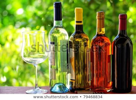 şarap şişeler gül restoran uzay Stok fotoğraf © inaquim