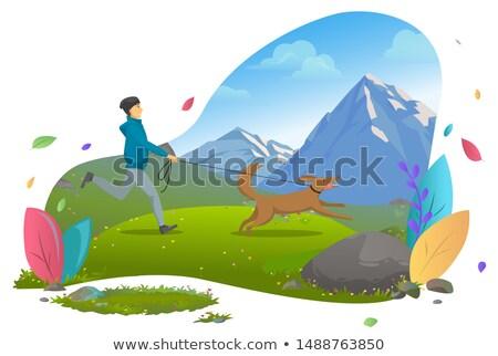 mountains landscape guy running with dog on leash stock photo © robuart