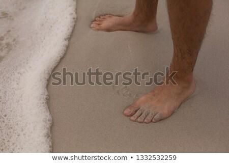 Alacsony részleg férfi áll tengerpart mezítláb Stock fotó © wavebreak_media