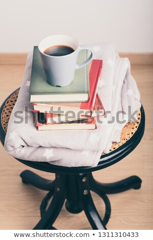 A few books with cup of coffee on chair Stock photo © przemekklos