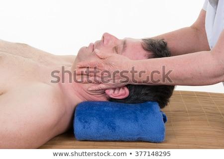 Man receiving Shiatsu massage from a professional Stock photo © Lopolo