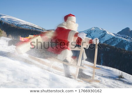 Santa descends from the mountain on a sled Stock photo © liolle