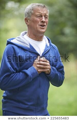 Kıdemli adam kalp krizi jogging egzersiz Stok fotoğraf © HighwayStarz