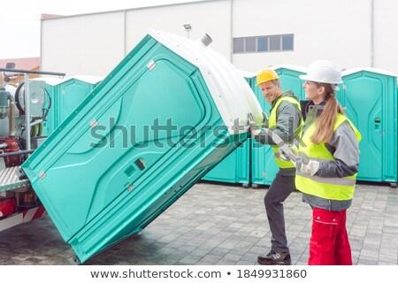 Werknemer draagbaar vrachtwagen levering business vrouw Stockfoto © Kzenon