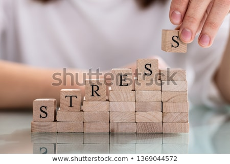 Person's Hand Placing Last Alphabet Of Word Stress Stock photo © AndreyPopov