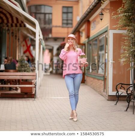 Gyönyörű lány rózsaszín ruha ül kávézó tabletta Stock fotó © ElenaBatkova