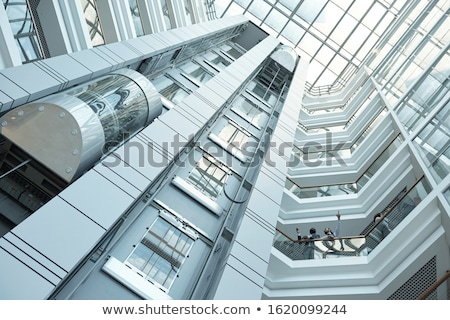 Below view of elevator, walls and balconies of contemporary business center Stock photo © pressmaster