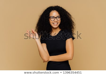 Sorridente feminino africano okay gesto Foto stock © vkstudio