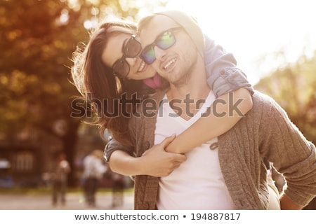 Piggyback couple autumn Stock photo © Lopolo