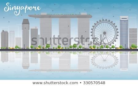 Singapore skyline with grey landmarks, blue sky and reflections Stock photo © ShustrikS