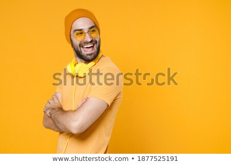 Image of young bearded man wearing basic white t-shirt looking aside Stock photo © deandrobot