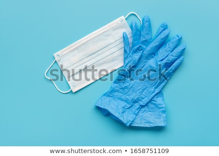 surgical gloves and mask on a blue background Stock photo © nito