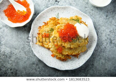 potato pancakes salmon fish and red caviar Stock photo © olira