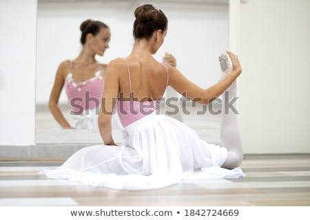 Image of caucasian woman ballerina practicing and stretching her Stock photo © deandrobot