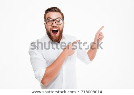 Image closeup of young bearded man pointing finger at copyspace Stock photo © deandrobot