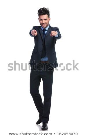 Jeune homme pointant tous les deux mains blanche sourire Photo stock © Rebirth3d